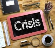 Crisis - Tekst op Klein Bord 3D Illustratie Royalty-vrije Stock Afbeelding