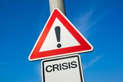 Crisis. Traffic sign with exclamation mark to alert, warn caution - crash, failure and collapse leading to negative and bad problems Stock Image