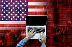 Crisis in USA - Shares Fall Graph on United States of America Flag Royalty Free Stock Images