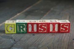 Crisis wood blocks Stock Photo