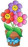Crisol con tres flores de la historieta Imagen de archivo libre de regalías