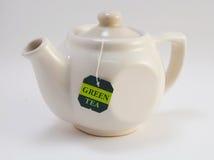Crisol de té en blanco Fotografía de archivo libre de regalías