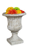 Crisol grande con las flores artificiales Fotografía de archivo libre de regalías