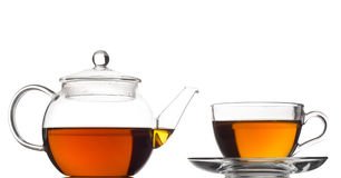 Crisol y taza del té fotos de archivo
