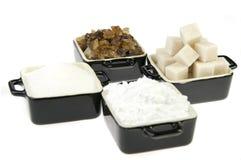 Crisoles con diversos tipos de azúcar Fotos de archivo libres de regalías