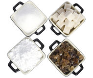 Crisoles con diversos tipos de azúcar Imagen de archivo