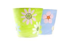 Crisoles de flor coloridos pintados de la arcilla Fotos de archivo