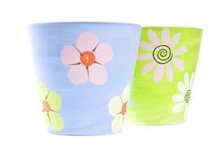 Crisoles de flor coloridos pintados de la arcilla Imágenes de archivo libres de regalías