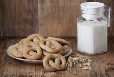 Crisp biscuit baked   and a jug of milk Stock Photography