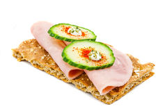 Crisp Bread 4. Crisp bread with two slices of cucumber and ham royalty free stock images