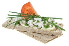 Crisp bread with cottage cheese tomato and chives Royalty Free Stock Photos