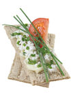 Crisp bread with cottage cheese tomato and chives Royalty Free Stock Image