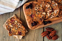 Crisp bread with cranberries, nuts and seeds, above on wood Stock Photos