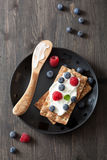 Crisp bread with creme fraiche and berries Royalty Free Stock Photography