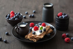 Crisp bread with creme fraiche and berries Stock Photo