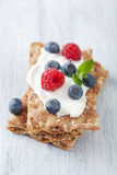 Crisp bread with creme fraiche and berries Royalty Free Stock Photo