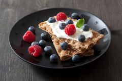 Crisp bread with creme fraiche and berries Stock Image