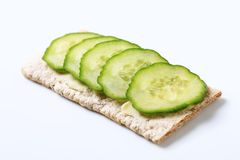 Crisp bread with fresh cucumber Stock Photos
