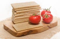 Crisp bread with fresh tomato Stock Image