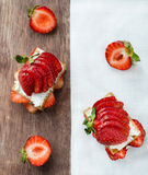 Crisp bread with goat cheese and strawberries Stock Images