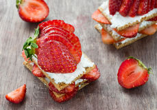 Crisp bread with goat cheese and strawberries Royalty Free Stock Photo