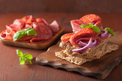 Crisp bread with salami and red onion Royalty Free Stock Image