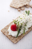 Crisp bread sandwich. With cream cheese, broccoli sprouts, tomato and chive Royalty Free Stock Photography