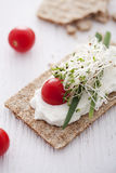 Crisp bread sandwich. With cream cheese, broccoli sprouts, tomato and chive Royalty Free Stock Photos