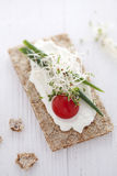 Crisp bread sandwich. With cream cheese, broccoli sprouts, tomato and chive Royalty Free Stock Images