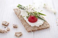 Crisp bread sandwich. With cream cheese, broccoli sprouts, tomato and chive Stock Image
