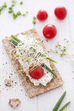 Crisp bread sandwich. With cream cheese, broccoli sprouts, tomato and chive Stock Photos