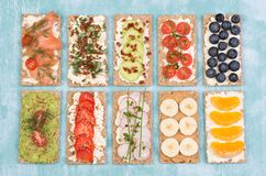 Crisp bread sandwiches with various toppings stock photos