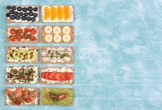 Crisp bread sandwiches with various toppings, top view with copy space stock photo