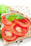 Crisp Bread With Tomato. Slices. Spiced with sea salt and black pepper stock photography