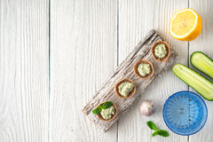 Crisp bread with tzatziki on the white wooden table top view Royalty Free Stock Photo