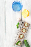 Crisp bread with tzatziki on the white wooden table vertical Stock Photo