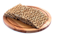 Crisp bread on a wooden tray, isolated Royalty Free Stock Photos