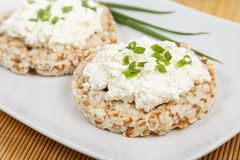 Crisp breads with cottage cheese and onion Stock Photo