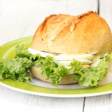 Crisp bun with egg and lettuce filling Stock Photos