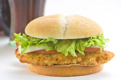 Crisp chicken burger tomato onion cheese lettuce Royalty Free Stock Images