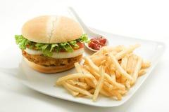Crisp chicken burger tomato onion cheese lettuce Royalty Free Stock Photography