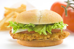 Crisp chicken burger tomato onion cheese lettuce Royalty Free Stock Photos