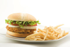 Crisp chicken burger tomato onion cheese lettuce Stock Images