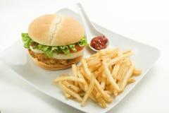 Crisp chicken burger tomato onion cheese lettuce Stock Photos