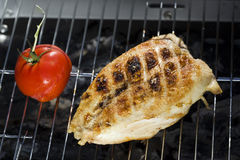 Crisp chicken and grilled tomato Royalty Free Stock Photo