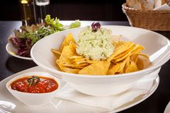 Crisp corn nachos with guacamole sauce Royalty Free Stock Image
