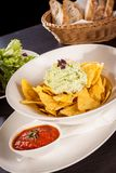 Crisp corn nachos with guacamole sauce Stock Images