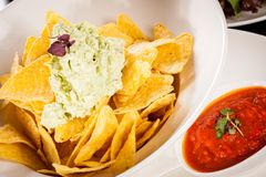 Crisp corn nachos with guacamole sauce Stock Photography