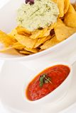 Crisp corn nachos with guacamole sauce Stock Photo