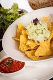 Crisp corn nachos with guacamole sauce Stock Photo
